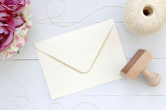 Mockup of envelope with a rubber stamp next to it. Modern trend template for advertising. Stock Image
