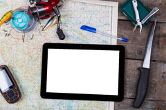 Mockup with fishing tackles and navigator on map Stock Images