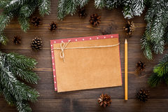 Mockup For New Year 2018. Sheet Of Paper, Greeting Card Near Spruce Branches, Pine Cone On Wooden Background Top View