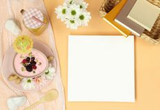 Mockup frame with books, breakfast and bouquet stock photo