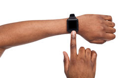 Mockup of hand wearing smart watch, cutout Stock Photo