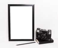 Mockup in hipster style workspace. Blank black picture frames on on  white background ,Vintage camera, notebook. Mockup in hipster style workspace Royalty Free Stock Photo