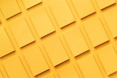 Mockup of horizontal golden business cards stacks arranged in rows at textured paper. Background. Top view Stock Images