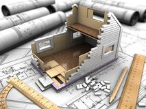 Mockup of the house and drawings. 3D structure of the floors of the house on the background blueprints Stock Photo