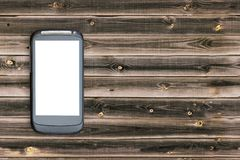 Mockup image of black mobile smartphone with blank white screen on vintage brown wood table background. Mock up of application wit. Mockup image of black mobile Stock Photo
