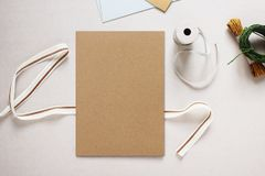 Mockup image of Brown Paper Invitation Card. Surrounded by Craft. Equipment, Flat Lay Design, Vintage Style, Top View stock image