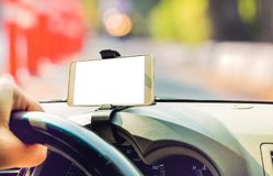 Mockup image of car holding mobile phone with blank white screen in car