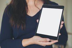 Free Mockup Image Of A Business Woman Holding And Showing Black Tablet With Blank White Screen Royalty Free Stock Photography - 104518567
