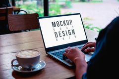 Free Mockup Image Of A Business Woman Using And Typing On Laptop Computer Keyboard With Blank White Desktop Screen With Coffee Latte Royalty Free Stock Photography - 156488647