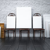 Mockup interior 3d. paintings on chairs in the studio Royalty Free Stock Images