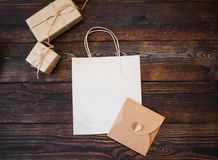 Mockup kraft gift boxes with package on wooden background Royalty Free Stock Images