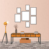Mockup living room interior in hipster style with empty frames, brick flooring and concrete wall. Loft design concept. Royalty Free Stock Photo