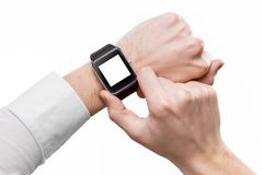 Mockup of male hands with smart watch with blank screen isolated.  Royalty Free Stock Images