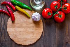 Mockup for menu. Cutting board and vegetables on wooden table background top view copyspace Royalty Free Stock Photos