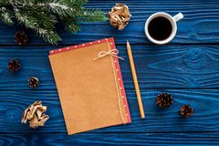 Mockup for new year 2018. Sheet of paper near coffee, spruce branches, pine cone on blue wooden background top view Royalty Free Stock Images