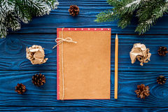 Mockup for new year 2018. Sheet of paper near spruce branches, pine cone on blue wooden background top view Royalty Free Stock Images