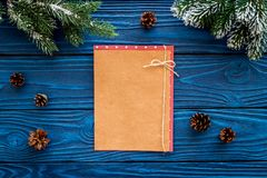 Mockup for new year 2018. Sheet of paper near spruce branches, pine cone on blue wooden background top view Royalty Free Stock Photography