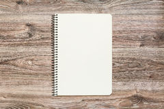 Mockup of open notepad with blank page on wooden background. Stock Photo