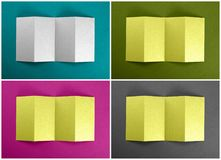 Mockup of opened four fold brochures at colored backgrounds. Mockup of opened four fold brochures at colored backgrounds Stock Image