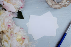 Mockup with peony. wooden background. notebook with your text. business card Stock Photos