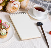 Mockup photography with flowers, notebook, pen and tea Royalty Free Stock Image
