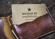 Mockup by Rawpixel Business Card Inside Brown Leather Wallet royalty free stock photos