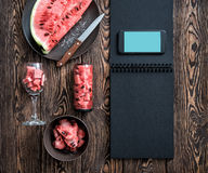 Mockup of the smartphone next to watermelon slices. Clipping path Stock Photography