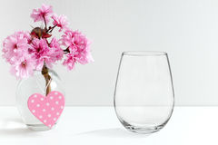 Mockup - stemless wine glass, next to blossom in a vase. Floral mock-up of a stemless wine glass, perfect for businesses who sell decals, vinyl stickers, just stock photography