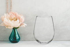 Mockup - stemless wine glass, next to a peony in a vase. Floral mock-up of a stemless wine glass, perfect for businesses who sell decals, vinyl stickers, just stock images