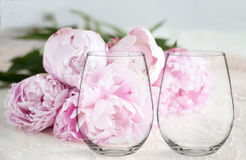 Mockup - 2 stemless wine glasses, with peonies behind. Floral mock-up of 2 stemless wine glasses, in front of a bunch of peonies, perfect for businesses who sell Royalty Free Stock Images