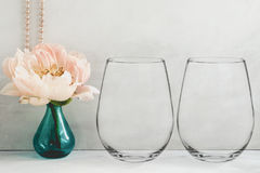 Mockup - stemless wine glasses, peony in a vase Stock Photography