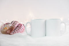 Mockup Styled Stock Product Image, two white mugs that you can add your custom design/quote to. Royalty Free Stock Photo