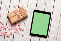 Mockup of tablet pc with gift box Royalty Free Stock Photography