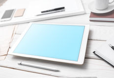 Mockup of tablet pc on the table Royalty Free Stock Image