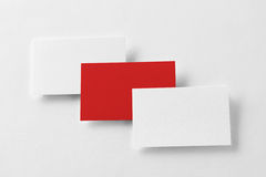 Mockup of three red and white business cards row at textured pap stock photography