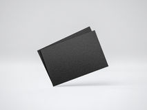 Mockup of two black business cards. 3d rendering Stock Photos