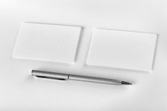 Mockup of two horizontal business cards and pen at white texture Stock Photos