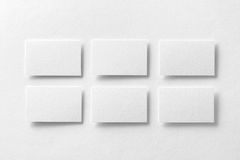 Mockup of white business cards arranged in rows at white design. Paper background Royalty Free Stock Photos