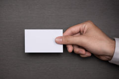 Mockup of white business cards in man`s hand Royalty Free Stock Image