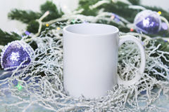 Mockup of white Mug or cup for winter gifts design, Merry Christmas, Happy New Year. Royalty Free Stock Images