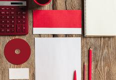 The mockup on wooden background with red Stock Photos