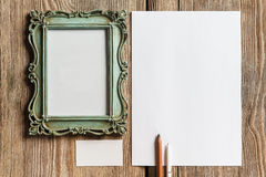 The mockup on wooden background with vintage old stock photography