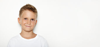 Mockup of young smiling kid looking on the white Royalty Free Stock Photos
