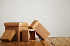 Mockups of blank brown corrugated cardboard boxes stock photography