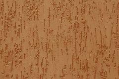 Modèle abstrait avec de relief du stuc jaune sur un mur en béton Surface de mur orange cannelé Texture de parge brun clair image stock