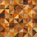 Modèle abstrait de triangle - différentes couleurs - fond en bois Image libre de droits