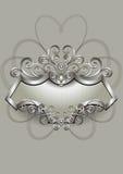 Modèle argenté avec l'héraldique et spirales sur un cadre argenté Images libres de droits