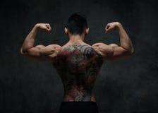 Modèle asiatique avec le tatouage photographie stock