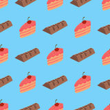 Modèle avec du chocolat et le gâteau sur le fond bleu Photo libre de droits