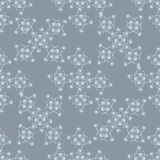 Modèle blanc sans couture d'hiver sur un fond bleu images stock